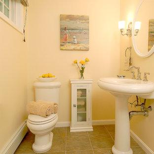 Immagine di una stanza da bagno con doccia design di medie dimensioni con ante di vetro, ante bianche, WC a due pezzi, piastrelle beige, piastrelle in ceramica, pareti beige, pavimento con piastrelle in ceramica e lavabo a colonna