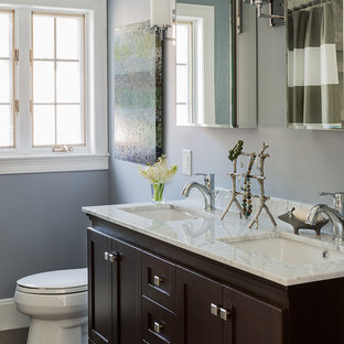 Mid-sized elegant bathroom photo in Boston with an undermount sink, shaker cabinets and dark wood cabinets