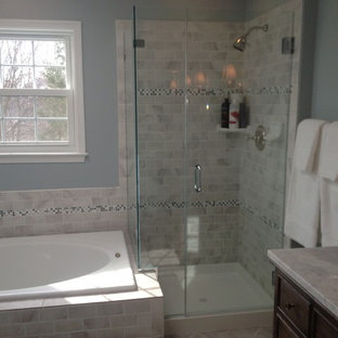 Example of a mid-sized classic master gray tile, white tile and subway tile bathroom design in DC Metro with dark wood cabinets, blue walls and marble countertops