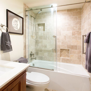 Inspiration for a small mediterranean 3/4 beige tile and ceramic tile ceramic floor and beige floor bathroom remodel in San Francisco with quartzite countertops, recessed-panel cabinets, medium tone wood cabinets, a two-piece toilet, white walls and an undermount sink