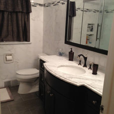 Traditional Bathroom by Total Kitchen & Bath, Inc