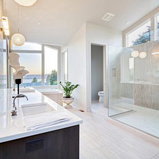 Example of a huge minimalist master porcelain tile and beige floor bathroom design in New York with dark wood cabinets, a two-piece toilet, white walls, an undermount sink, quartz countertops and white countertops