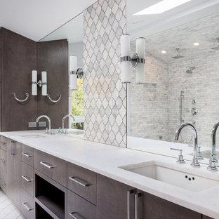 Esempio di una stanza da bagno padronale di medie dimensioni con ante marroni, doccia ad angolo, piastrelle bianche, piastrelle di cemento, pareti bianche, pavimento con piastrelle in ceramica, lavabo da incasso, top in granito, pavimento bianco, porta doccia a battente e top bianco