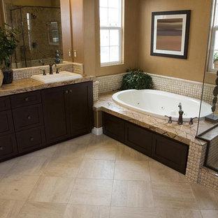 サンフランシスコの広いコンテンポラリースタイルのおしゃれなマスターバスルーム (シェーカースタイル扉のキャビネット、黒いキャビネット、置き型浴槽、コーナー設置型シャワー、セラミックタイル、ベージュの壁、磁器タイルの床、オーバーカウンターシンク、御影石の洗面台、ベージュの床、開き戸のシャワー、ベージュのカウンター、洗面台2つ、造り付け洗面台、表し梁) の写真