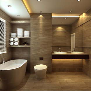 Mid-sized minimalist master beige tile, brown tile and travertine tile travertine floor and brown floor freestanding bathtub photo in Los Angeles with a one-piece toilet, a drop-in sink, solid surface countertops, open cabinets, brown cabinets and brown walls