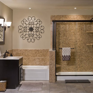Medium sized mediterranean ensuite bathroom in Grand Rapids with flat-panel cabinets, black cabinets, an alcove shower, beige tiles, ceramic tiles, beige walls, ceramic flooring, an integrated sink, laminate worktops, beige floors and a sliding door.