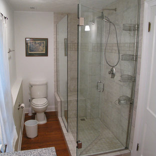 Design ideas for a small modern family bathroom in Chicago with freestanding cabinets, pink tiles, mirror tiles and laminate worktops.