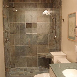 Small modern family bathroom in Chicago with freestanding cabinets, pink tiles, mirror tiles and laminate worktops.