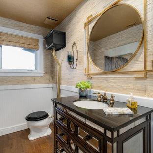 Идея дизайна: ванная комната среднего размера в стиле современная классика с стеклянными фасадами, фасадами цвета дерева среднего тона, инсталляцией, серыми стенами, полом из керамогранита, душевой кабиной, врезной раковиной, столешницей из гранита, бежевым полом, черной столешницей, тумбой под одну раковину, напольной тумбой, потолком с обоями и обоями на стенах