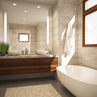 Design ideas for a small modern master bathroom in San Francisco with a vessel sink, flat-panel cabinets, medium wood cabinets, limestone benchtops, a freestanding tub, beige tile, stone tile and brown walls.