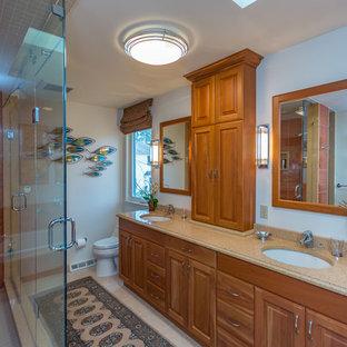 Imagen de cuarto de baño principal, de estilo zen, de tamaño medio, con armarios con paneles con relieve, puertas de armario de madera oscura, bañera encastrada, ducha empotrada, baldosas y/o azulejos rojos, baldosas y/o azulejos de porcelana, paredes blancas, suelo de baldosas de porcelana, lavabo bajoencimera, encimera de cuarzo compacto, suelo blanco, ducha con puerta con bisagras y encimeras beige