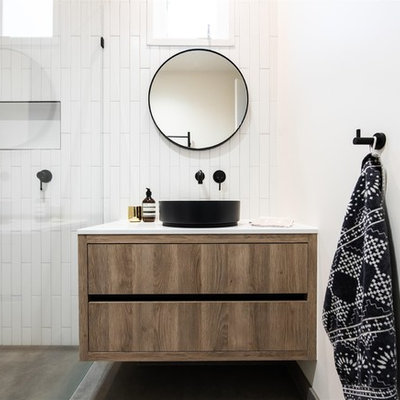 Inspiration for a mid-sized contemporary master white tile and ceramic tile porcelain tile bathroom remodel in Melbourne with white walls, quartz countertops, white countertops, flat-panel cabinets, medium tone wood cabinets and a wall-mount sink