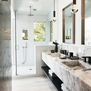 This is an example of a mid-sized contemporary master bathroom in Brisbane with open cabinets, white tile, subway tile, white walls, an integrated sink, a hinged shower door, white cabinets, an open shower, light hardwood floors, marble benchtops and grey benchtops.