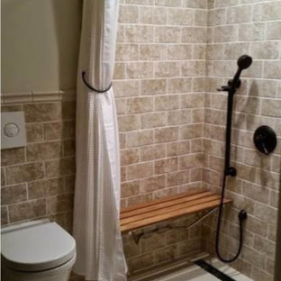 Small transitional 3/4 bathroom with beige tile, a curbless shower, a wall-mount toilet, stone tile, beige walls, bamboo floors, beige floor and a shower curtain.