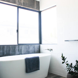 Large minimalist master white tile and ceramic tile wood-look tile floor and multicolored floor bathroom photo in Perth with flat-panel cabinets, blue cabinets, multicolored walls, a vessel sink, quartz countertops, a hinged shower door and white countertops