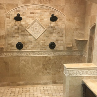 Inspiration for a large mediterranean master bathroom in New York with raised-panel cabinets, dark wood cabinets, a double shower, beige tile, travertine, beige walls, travertine floors, a vessel sink, tile benchtops, beige floor and an open shower.