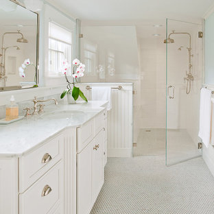 Inspiration for a large timeless master white tile and subway tile mosaic tile floor and white floor bathroom remodel in Providence with an undermount sink, recessed-panel cabinets, white cabinets, blue walls, marble countertops, a hinged shower door and white countertops