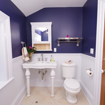 Example of a classic beige floor claw-foot bathtub design in Cleveland with a console sink and purple walls