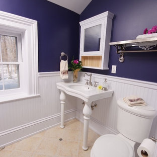 Inspiration for a timeless bathroom remodel in Cleveland with a console sink