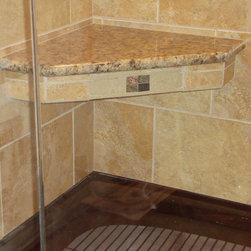 Bathroom Retreat - This master bathroom has everything!  Cast iron shower pan, Basco shower door, granite seat, custom tile design.  Shower jet fixtures.