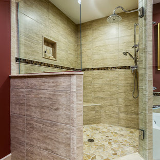 Example of a large classic master multicolored tile and stone tile travertine floor and beige floor bathroom design in Detroit with an undermount sink, shaker cabinets, medium tone wood cabinets, engineered quartz countertops, a two-piece toilet, red walls and a hinged shower door