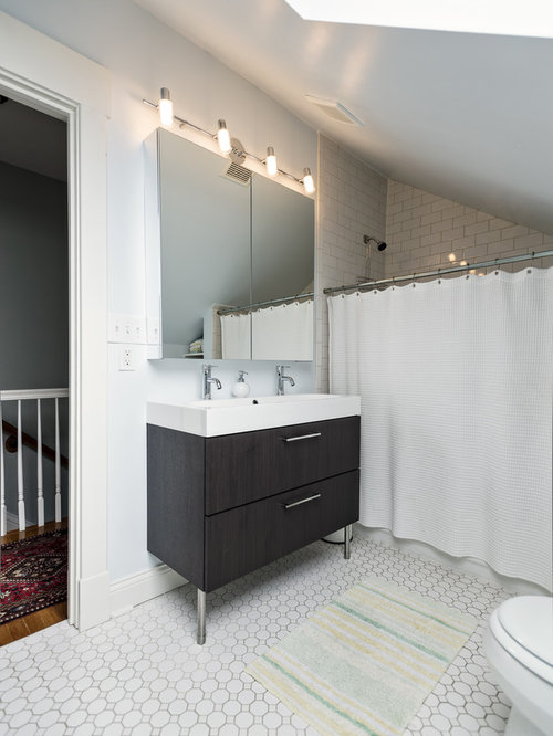 Transitional bathroom idea in Louisville with subway tile