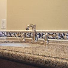 Tropical Bathroom by Steigerwald-Dougherty, Inc.