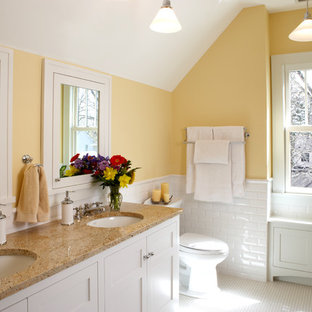 Example of a classic 3/4 white tile and subway tile white floor bathroom design in Minneapolis with shaker cabinets, white cabinets, yellow walls and an undermount sink