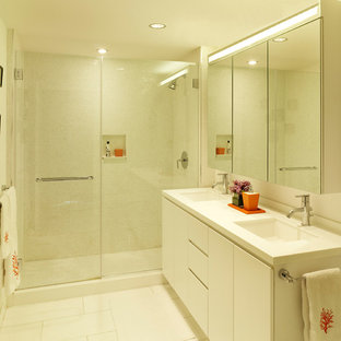 Design ideas for a mid-sized contemporary master bathroom in New York with an undermount sink, flat-panel cabinets, white cabinets, an alcove shower, mosaic tile and white walls.