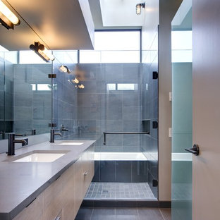 Example of a mid-sized trendy master gray tile and stone tile slate floor bathroom design in Seattle with an undermount sink, flat-panel cabinets, light wood cabinets, beige walls, engineered quartz countertops and gray countertops