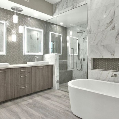 Bathroom - modern master gray tile and glass tile light wood floor bathroom idea in Phoenix with white walls, a pedestal sink, marble countertops, a hinged shower door and white countertops