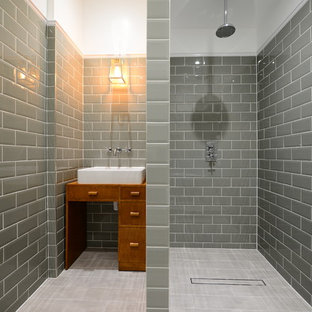 Inspiration for a medium sized traditional ensuite bathroom in London with freestanding cabinets, medium wood cabinets, porcelain flooring, a vessel sink, a walk-in shower, grey tiles, metro tiles and an open shower.