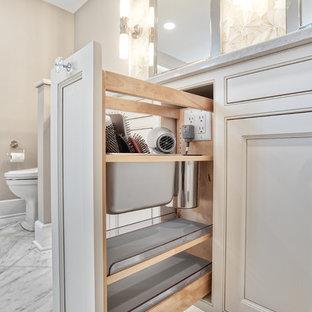 На фото: большая главная ванная комната в классическом стиле с фасадами с декоративным кантом, полновстраиваемой ванной, белой плиткой, плиткой мозаикой, мраморным полом, врезной раковиной, столешницей из кварцита, белым полом, душем с распашными дверями и белой столешницей
