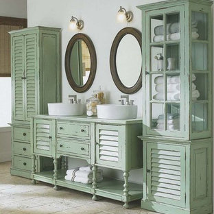 Inspiration for a small shabby-chic style master bathroom in Other with louvered cabinets, medium wood cabinets, a claw-foot tub, a one-piece toilet, beige tile, stone tile, multi-coloured walls, light hardwood floors, wood benchtops and a vessel sink.
