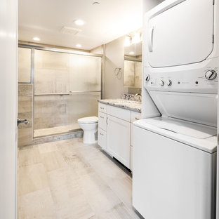 Bathroom - mid-sized transitional master gray tile and ceramic tile ceramic floor and gray floor bathroom idea with shaker cabinets, white cabinets, a one-piece toilet, beige walls, an undermount sink, granite countertops and multicolored countertops