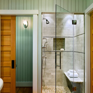 Inspiration for a beach style bathroom in Portland Maine with subway tile and pebble tile floors.