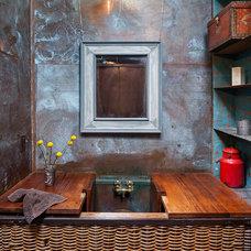 Industrial Bathroom by KuDa Photography