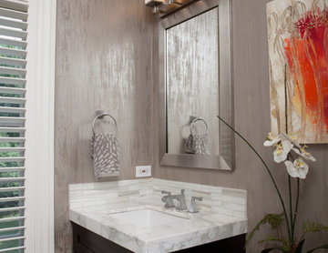 Bathroom with Silver Wallpaper and Marble Countertop