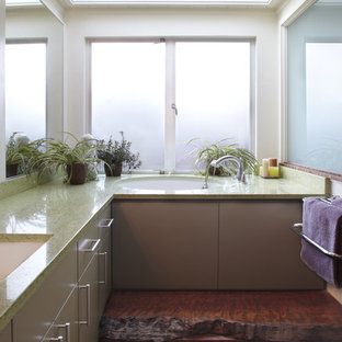 Inspiration for a mid-sized modern master bathroom in San Francisco with an undermount sink, flat-panel cabinets, grey cabinets, green benchtops, an alcove tub, porcelain floors, granite benchtops and black floor.