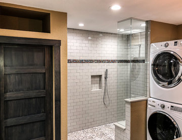 Bathroom with Walk-In Shower, Stackable Laundry, and Pocket Door to Toilet Close
