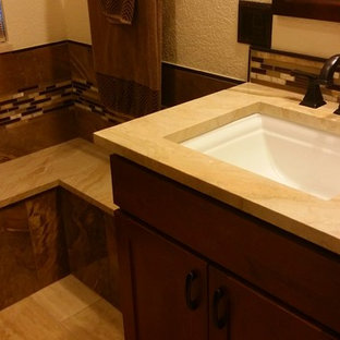Mid-sized trendy master brown tile and porcelain tile marble floor double shower photo in Denver with an undermount sink, shaker cabinets, medium tone wood cabinets, marble countertops, a two-piece toilet and blue walls