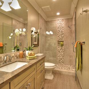 На фото: ванная комната среднего размера в стиле современная классика с фасадами с утопленной филенкой, бежевыми фасадами, душем в нише, раздельным унитазом, разноцветной плиткой, плиткой мозаикой, бежевыми стенами, полом из ламината, душевой кабиной, врезной раковиной, столешницей из оникса, бежевым полом и душем с распашными дверями с
