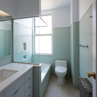 Inspiration for a small modern kids' green tile and glass tile porcelain floor and beige floor bathroom remodel in New York with furniture-like cabinets, a one-piece toilet, white cabinets, green walls, an undermount sink and concrete countertops