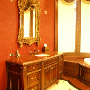 Inspiration for an expansive victorian master bathroom in New York with raised-panel cabinets, medium wood cabinets, an alcove tub, an alcove shower, orange walls, linoleum floors, an undermount sink, wood benchtops, multi-coloured floor, a hinged shower door and brown benchtops.