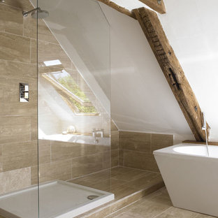 Inspiration for a small contemporary ensuite bathroom in Sydney with a freestanding bath, a walk-in shower, a wall mounted toilet, beige tiles, stone tiles, beige walls, limestone flooring, a wall-mounted sink and wooden worktops.
