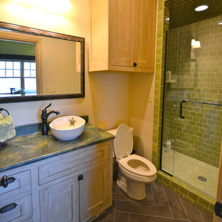 Medium sized mediterranean ensuite bathroom in Austin with shaker cabinets, white cabinets, an alcove bath, an alcove shower, a one-piece toilet, green tiles, glass tiles, purple walls, dark hardwood flooring, a vessel sink, marble worktops, brown floors and a hinged door.