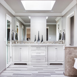 Inspiration for a mid-sized master gray tile and porcelain tile porcelain tile bathroom remodel in Kansas City with recessed-panel cabinets, white cabinets, a two-piece toilet, gray walls, an undermount sink and quartz countertops