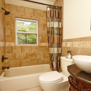 Example of a mid-sized classic 3/4 brown tile ceramic tile bathroom design in DC Metro with medium tone wood cabinets, a one-piece toilet, white walls, a vessel sink, furniture-like cabinets and granite countertops