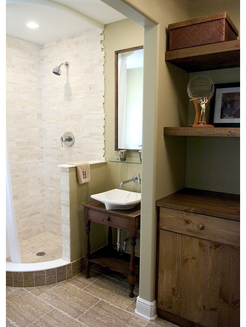 example of a trendy doorless shower design in tampa with a vessel sink and medium tone