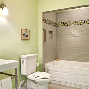 Inspiration for a mid-sized timeless subway tile and gray tile porcelain floor bathroom remodel in Charleston with a console sink, a two-piece toilet and green walls